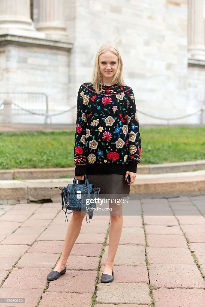 Polish model Maja Salamon carries a 31 Phillip Lim bag and wears vintage after Roberto Cavalli on Day 4 of Milan Fashion Week Spring/Summer 2015 on...