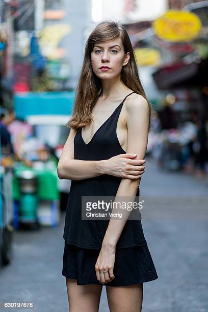 Polish model Zofia Baranska wearing a black top and bag from HM and black mini skirt from Stradivarius and nude heels on December 17 2016 in Bangkok...