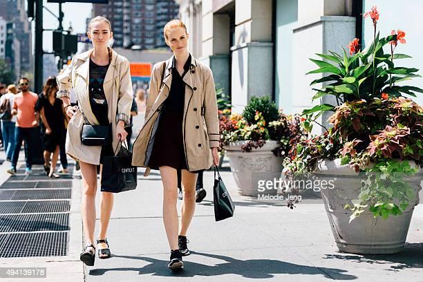 Polish models Kasia Jujeczka and Magdalena Jasek exit the Public School show at Skylight Monihan Square on September 13 2015 in New York City Both...