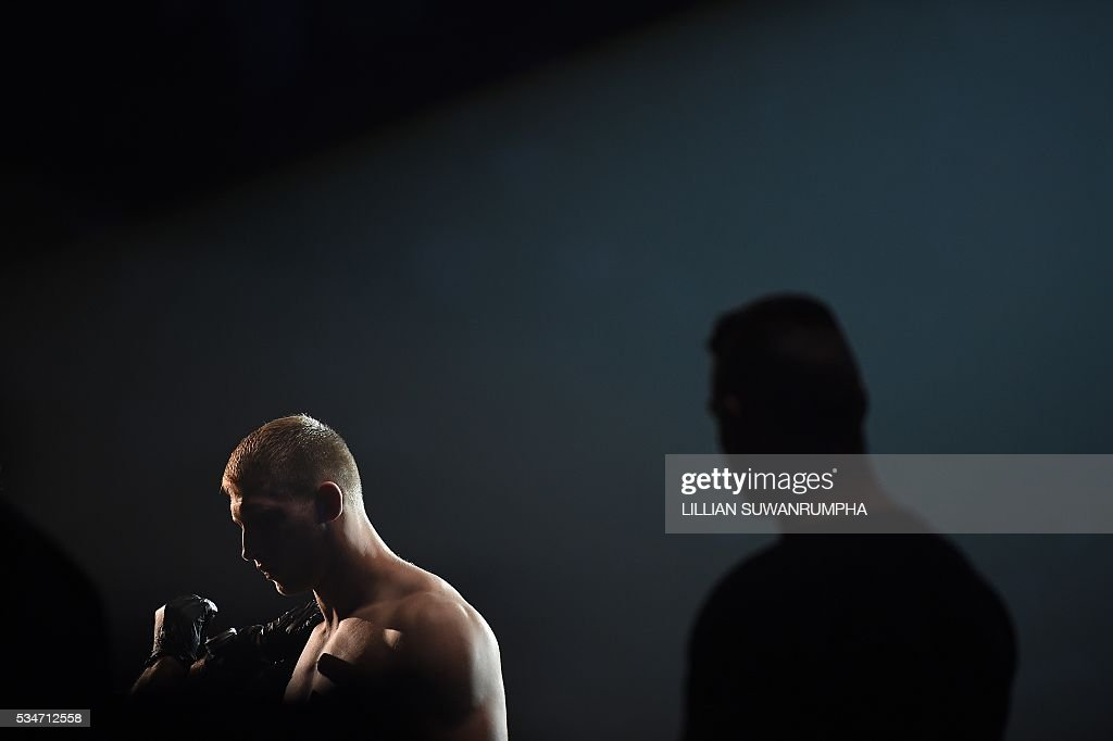 Polish ONE FC mixed martial artist Marchin Prachnio (L) is pictured prior to his match against Brazilian Leandro Ataides (not pictured) during the first ever ONE FC event in Bangkok on May 27, 2016. / AFP / LILLIAN