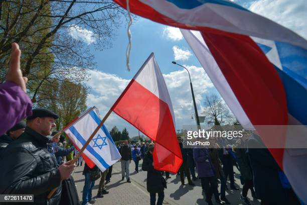Polish people welcome participants of the annual March of the Living outside the former German Nazi Death Camp AuschwitzBirkenau Jewish people from...