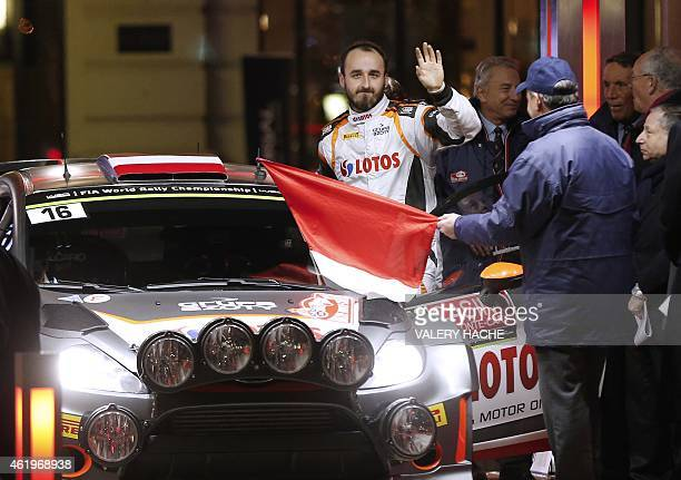 Polish pilot Robert Kubica waves before the start of the Rallye of MonteCarlo in Monaco on January 22 2015 AFP PHOTO / VALERY HACHE