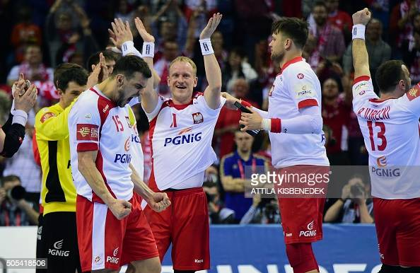 Polish players celebrate after winning the Men's 2016 EHF European Handball Championship match between Poland and Macedonia at the Tauron Arena of...