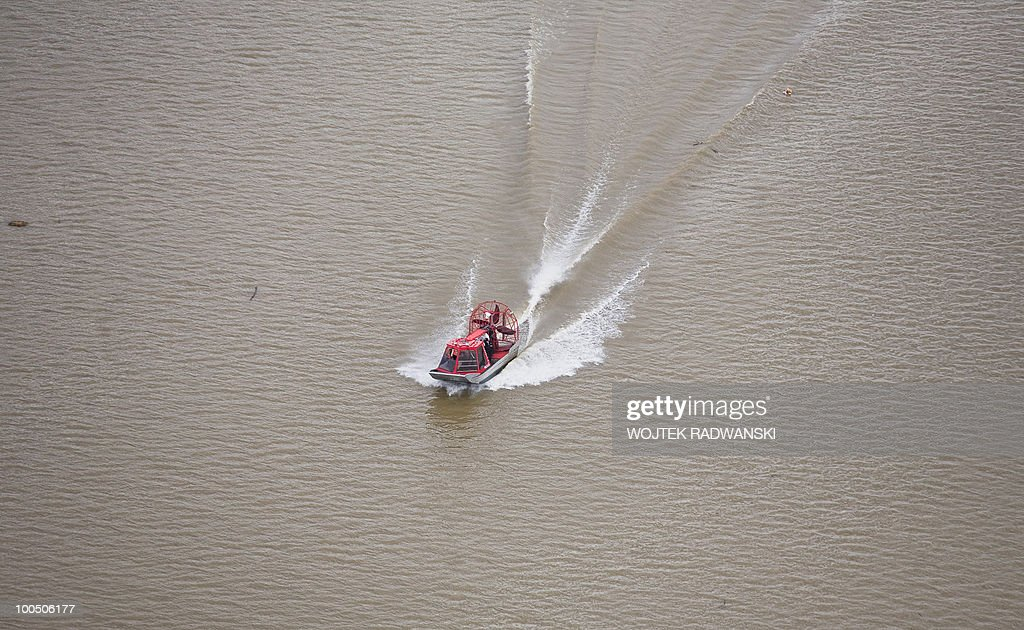 Polish police patrol a flooded area in the village of Swiniary in central Poland on Wisla river on May 25, 2010. Torrential rain in Poland's mountainous south have caused rivers, including the Vistula, Poland's largest, swell to levels unseen in more than a century.