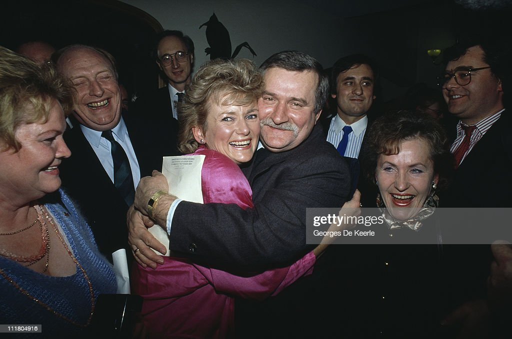 Polish politician <a gi-track='captionPersonalityLinkClicked' href=/galleries/search?phrase=Lech+Walesa&family=editorial&specificpeople=93677 ng-click='$event.stopPropagation()'>Lech Walesa</a> embraces Glenys Kinnock, wife of British Labour party leader <a gi-track='captionPersonalityLinkClicked' href=/galleries/search?phrase=Neil+Kinnock&family=editorial&specificpeople=178980 ng-click='$event.stopPropagation()'>Neil Kinnock</a> (left) during a visit to a Polish community in Britain, 1st December 1989.