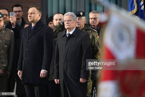 Polish President Andrzej Duda and German President Joachim Gauck review a gaurd of honour of German and Polish soldiers while visiting the NATO...