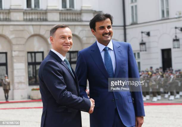 Polish President Andrzej Duda and the Emir of Qatar Sheikh Tamim bin Hamad Al Thani shake hands during the Emir's official visit to Poland on May 05...