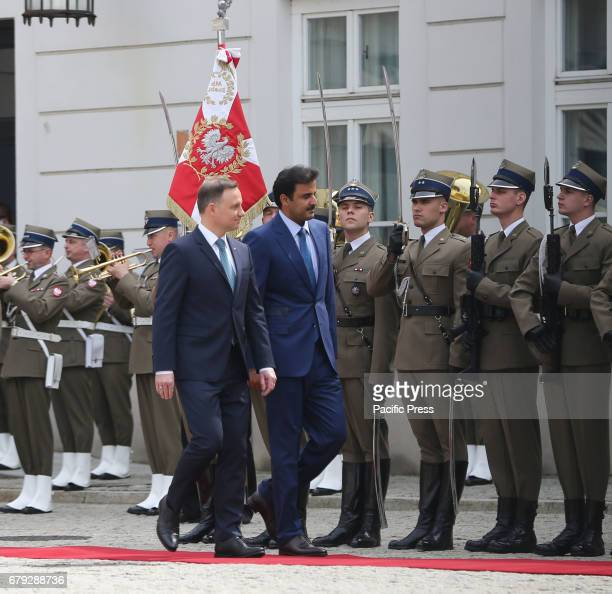 Polish President Andrzej Duda and the Emir of Qatar Sheikh Tamim bin Hamad Al Thani inspect the honorary guard during the Emir's official visit to...