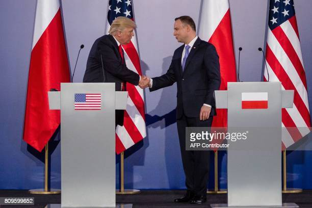 Polish President Andrzej Duda and US President Donald Trump shake hands after a joint press conference at the Royal Castle in Warsaw Poland July 6...