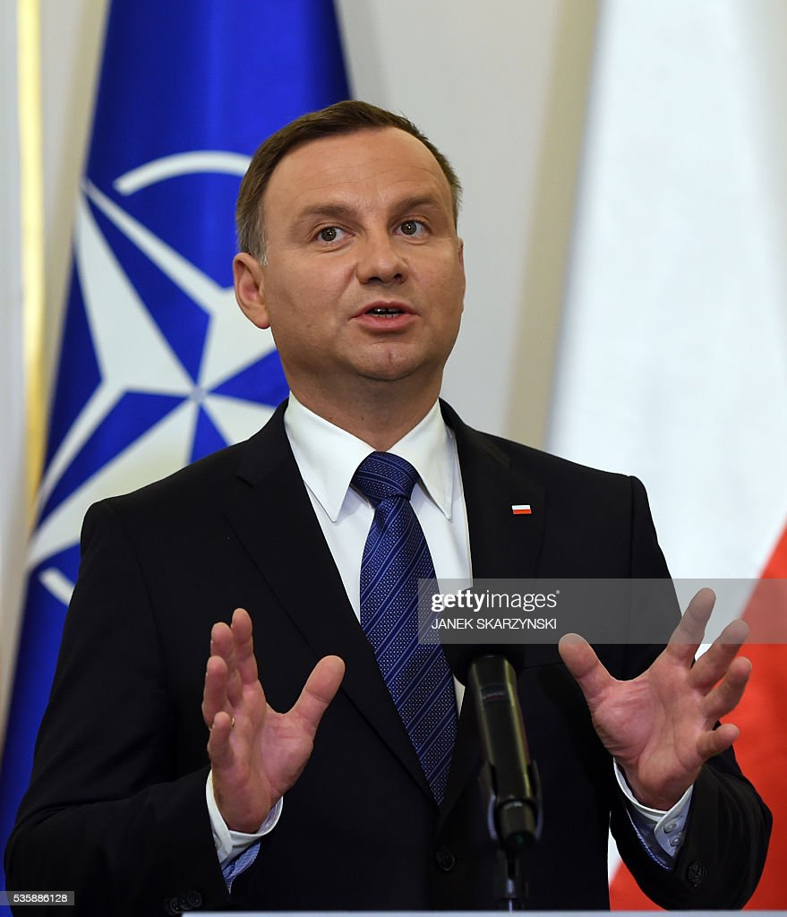 Polish President Andrzej Duda gestures during meeting with NATO Secretary General Jens Stoltenberg(not in a picture) on May 30, 2016 in Belweder palace in Warsaw. / AFP / JANEK