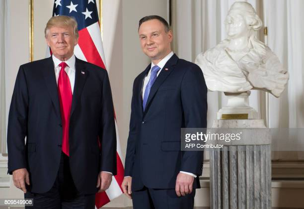 Polish President Andrzej Duda greets US President Donald Trump prior to meetings at the Royal Castle in Warsaw Poland July 6 2017 / AFP PHOTO / SAUL...