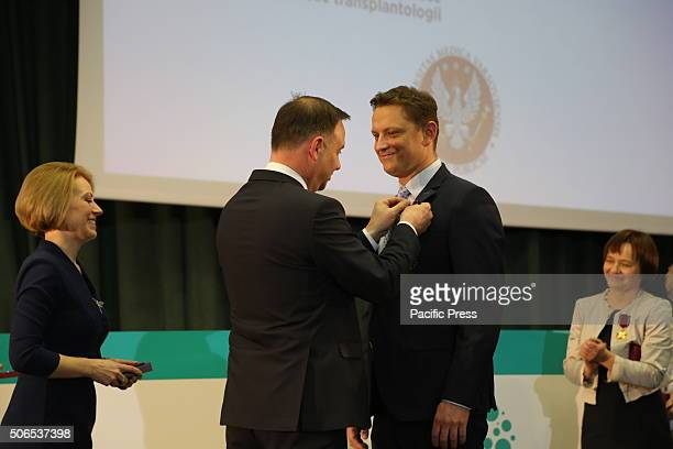 Polish President Andrzej Duda presents Bartosz Foroncewicz the Golden Cross of Merit during the 50th anniversary symposium of the first successful...
