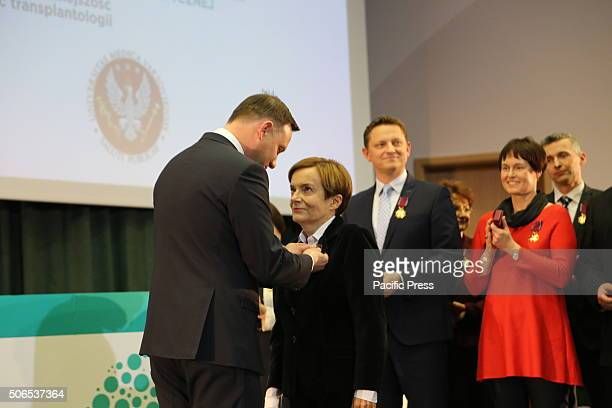 Polish President Andrzej Duda presents Ewa Nowacka Cieciura the Golden Cross of Merit during the 50th anniversary symposium of the first successful...