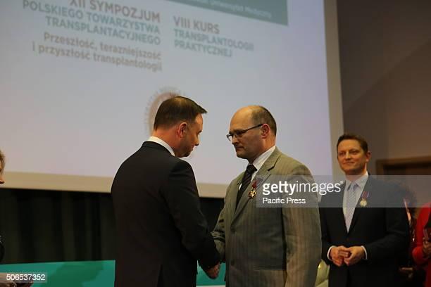 Polish President Andrzej Duda presents Grzegorz Senatorski the Golden Cross of Merit during the 50th anniversary symposium of the first successful...