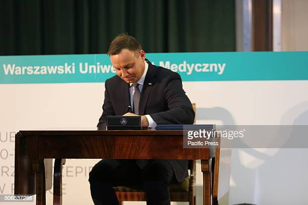 Polish President Andrzej Duda signs his own organ donation card at the 50th anniversary symposium of the first successful kidney transplant in Poland...