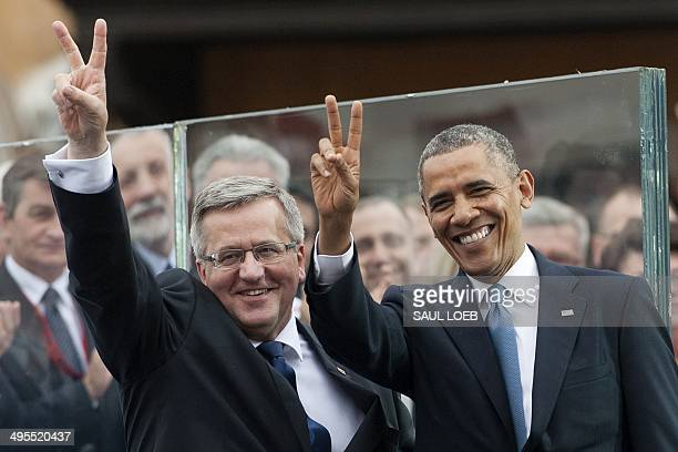 Polish President Bronislaw Komorowski and US President Barack Obama gesture as they attend the 25th Anniversary Freedom Day Event in honor of the...