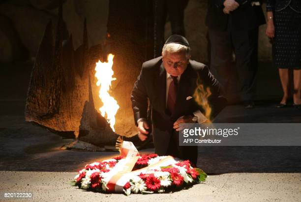 Polish President Lech Kaczynski lays a wreath close to the eternal flame in the Hall of Remembrance as he visits the Yad Vashem Holocaust Memorial...