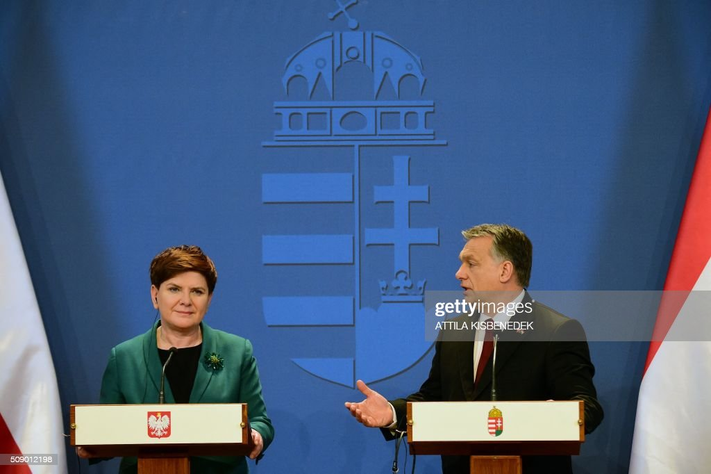 Polish Prime Minister Beata Szydlo (L) and her Hungarian counterpart Viktor Orban (R) attend a press conference on February 8, 2016 in Budapest. The Polish guest is on his one-daThe Polish guest is on his one-day working visit to Hungary.y working visit to Hungary.The Polish guest is on his one-day working visit to Hungary. / AFP / ATTILA KISBENEDEK