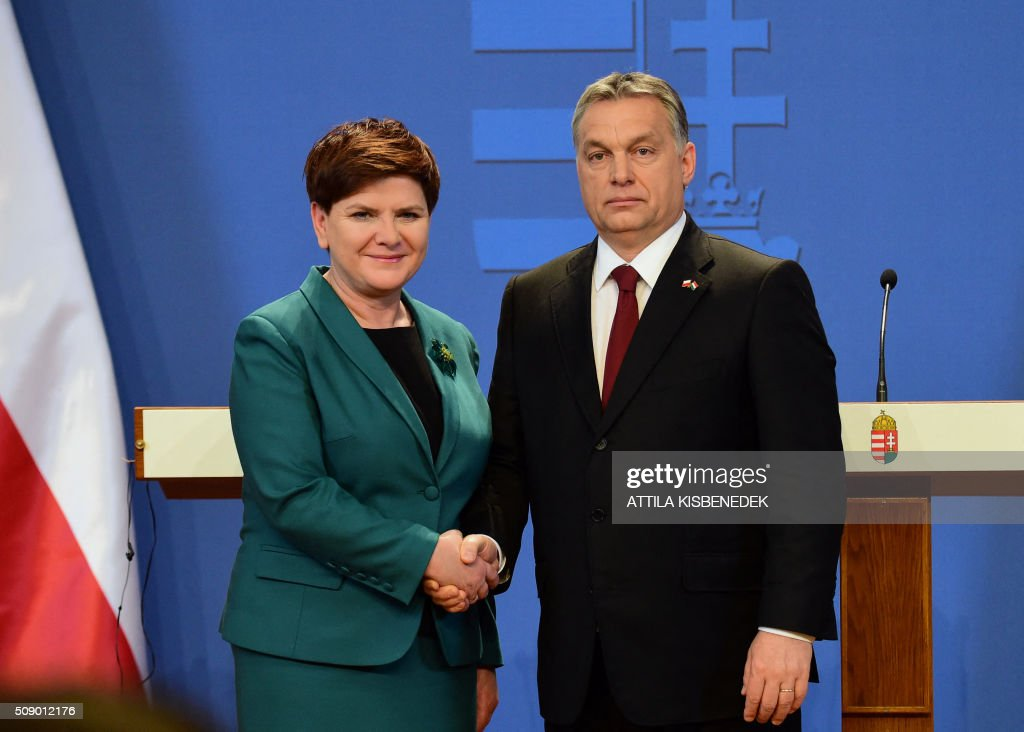 Polish Prime Minister Beata Szydlo (L) and her Hungarian counterpart Viktor Orban (R) pose for photographers on February 8, 2016 in Budapest after their press conference. The Polish guest is on his one-daThe Polish guest is on his one-day working visit to Hungary.y working visit to Hungary.The Polish guest is on his one-day working visit to Hungary. / AFP / ATTILA KISBENEDEK