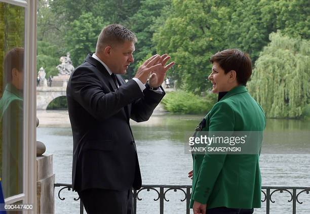 Polish Prime Minister Beata Szydlo and Slovak Prime Minister Robert Fico talk during a meeting at the Palace on the Isle in Warsaw's Lazienki Park on...