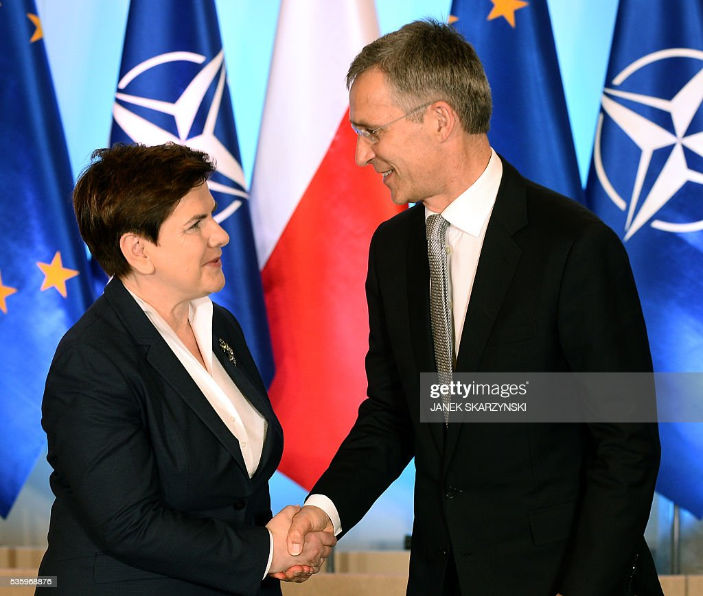 Polish Prime Minister Beata Szydlo (L) shakes hands with NATO Secretary General Jens Stoltenberg during their meeting on May 31, 2016 in Warsaw. In a few weeks Poland will hosts a NATO summit. / AFP / JANEK