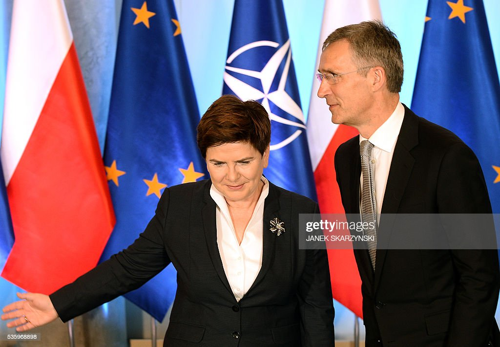 Polish Prime Minister Beata Szydlo (L) shows the way to NATO Secretary General Jens Stoltenberg during their meeting on May 31, 2016 in Warsaw. In a few weeks Poland will hosts a NATO summit. / AFP / JANEK