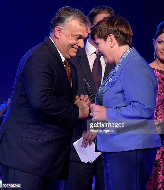 Polish Prime Minister Beata Szydo delivers the prize to the Hungarian Prime Minister Viktor Orban witch has been awarded as Men of the Year by the...