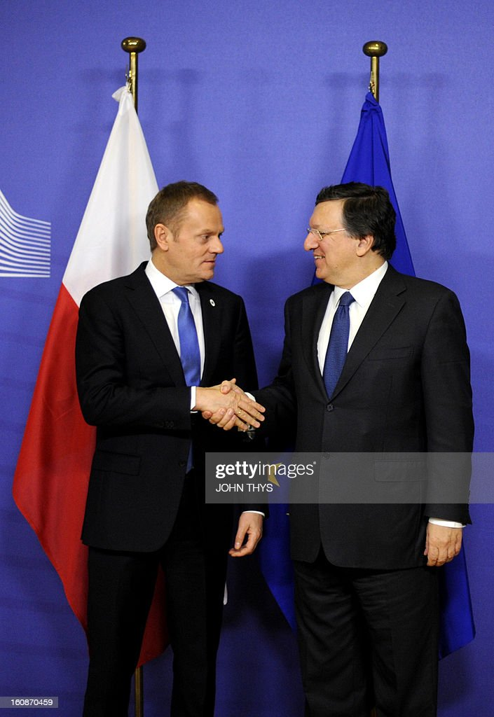 Polish Prime Minister Donald Tusk (L) and European Commission President Jose Manuel Barroso shake hands at the EU Headquarters on February 7, 2013 in Brussels, on the first day of a two-day European Union leaders summit. European Union leaders head into a fresh clash over the EU's budget with the only certainty being that proposals for several years will be cut back.
