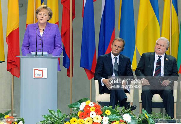 Polish Prime Minister Donald Tusk and former Polish President Lech Walesa the iconic Solidarity union leader listen to German Chancellor Angela...
