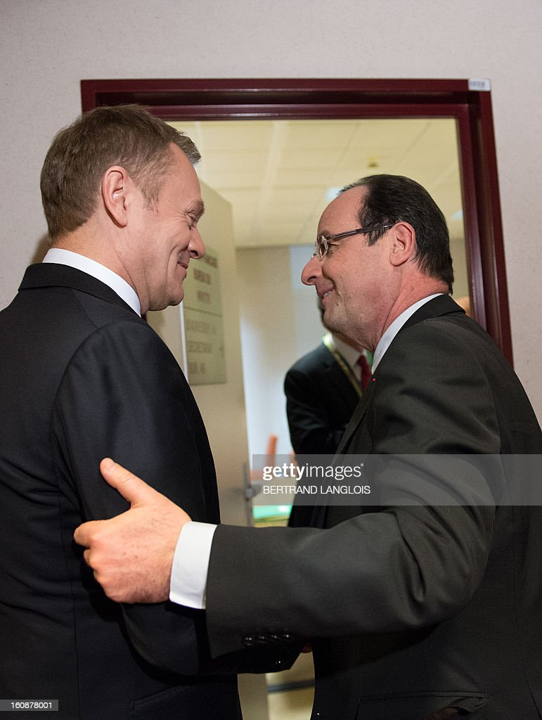 Polish Prime Minister Donald Tusk (L) and French President Francois Hollande meet at the EU Headquarters on February 7, 2013 in Brussels, on the first day of a two-day European Union leaders summit. European Union leaders head into a fresh clash over the EU's budget with the only certainty being that proposals for several years will be cut back. AFP PHOTO / BERTRAND LANGLOIS