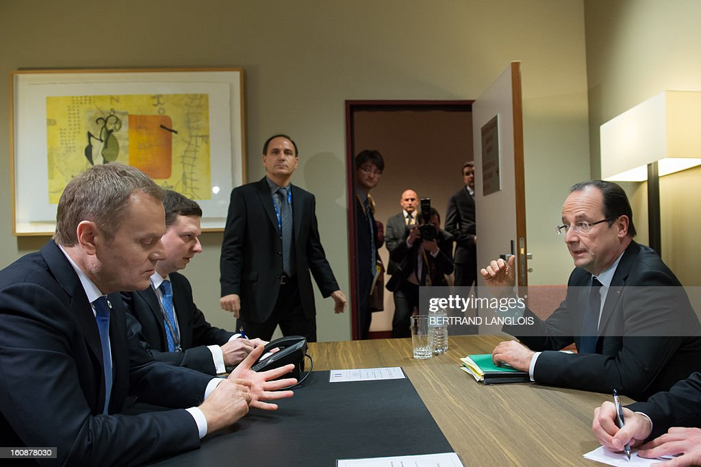 Polish Prime Minister Donald Tusk (L) and French President Francois Hollande (R) sit during a meeting at the EU Headquarters on February 7, 2013 in Brussels, on the first day of a two-day European Union leaders summit. European Union leaders head into a fresh clash over the EU's budget with the only certainty being that proposals for several years will be cut back. AFP PHOTO / BERTRAND LANGLOIS
