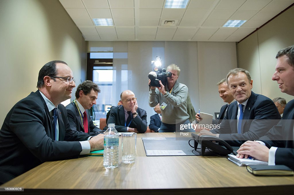 Polish Prime Minister <a gi-track='captionPersonalityLinkClicked' href=/galleries/search?phrase=Donald+Tusk&family=editorial&specificpeople=870281 ng-click='$event.stopPropagation()'>Donald Tusk</a> (2nd R) and French President Francois Hollande (L) sit during a meeting at the EU Headquarters on the first day of a two-day European Union leaders summit on February 7, 2013 in Brussels, Belgium, European Union leaders are set to duscuss the EU's budget.