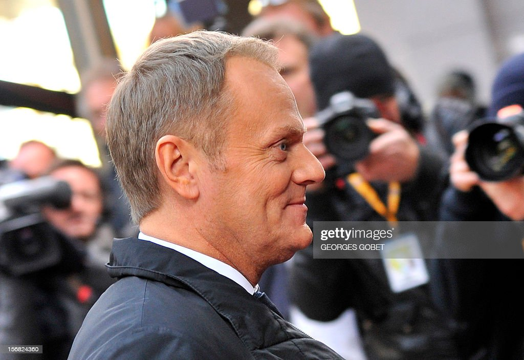 Polish Prime Minister Donald Tusk arrives at the EU Headquarters on November 22, 2012 in Brussels, to take part in a two-day European Union leaders summit called to agree a hotly-contested trillion-euro budget through 2020. European Union officials were scrambling to find an all but impossible compromise on the 2014-2020 budget that could successfully move richer nations looking for cutbacks closer to poorer ones who look to Brussels to prop up hard-hit industries and regions.