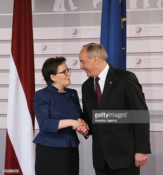 Polish Prime Minister Ewa Kopacz is welcomed by Latvian President Andris Berzins as she arrives at the House of the Blackhead for a dinner at the...