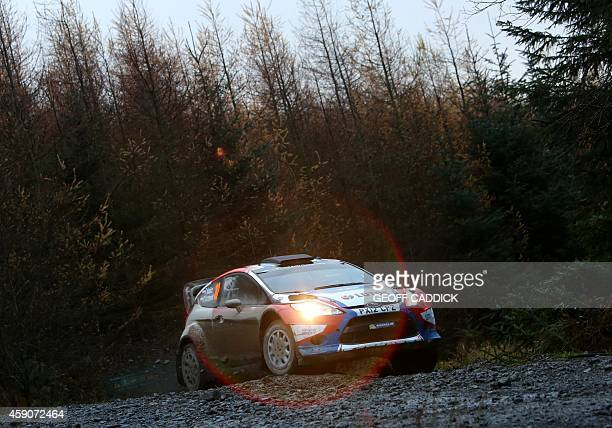 Polish rally driver Robert Kubica and codriver Maciej Szczepaniak driving their Ford Fiesta RS WRC in the Alwen Forest special stage of the 2014...