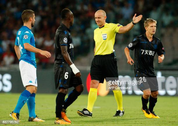 Polish referee Szymon Marciniak gestures near Nice's French midfielder Vincent Koziello and Nice's midfielder Jean Michaël Seri during the UEFA...