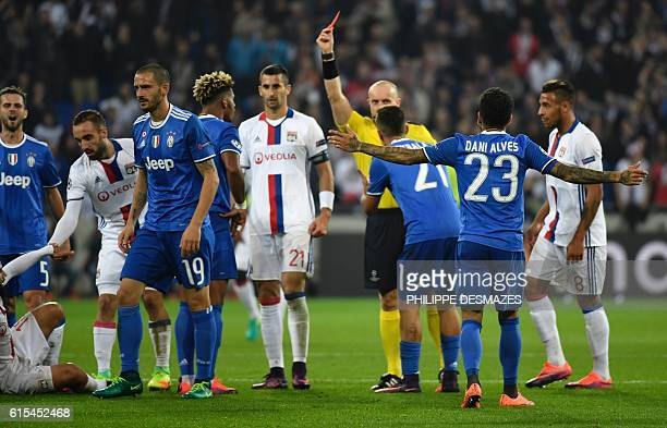 Polish referee Szymon Marciniak gives a red card to Juventus' French midfielder Mario Lemina during the Champions League football match between...
