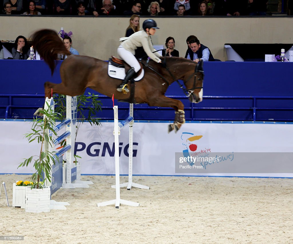 Polish rider paulina koza jumps with her horse for Show pool horse racing