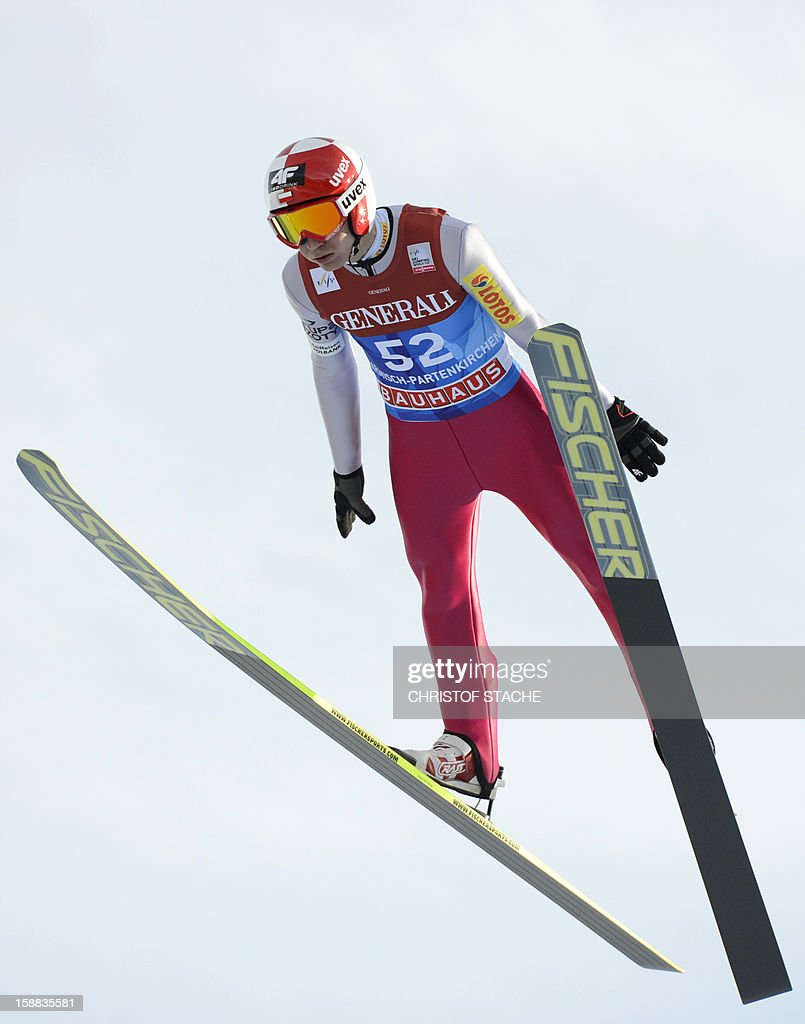 Polish ski jumper Kamil Stoch soars through the air during his trial jump at the 61th edition of the Four-Hills-Tournament (Vierschanzentournee) on December 31, 2012 in Garmisch-Partenkirchen, southern Germany. The second competition of the jumping event will take place in Garmisch-Partenkirchen, before the tournament continues in Innsbruck (Austria) and in Bischofshofen (Austria).