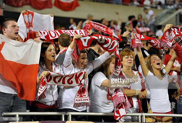 Polish soccer fans cheer on their team as they play against the USA during the second half on October 9 2010 at Soldier Field in Chicago Illinois The...