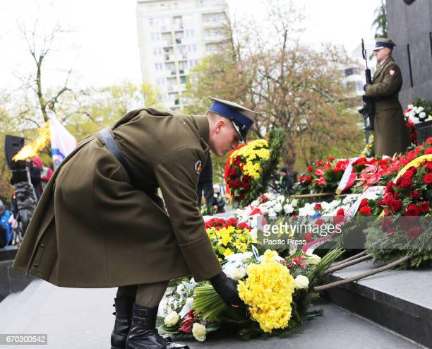 Polish soldier lay flowers during the 74th anniversary of the Warsaw Ghetto Uprising Flower were laid in front of the Ghetto Heroes Monument
