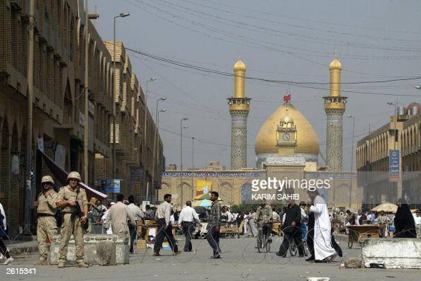 Polish soldiers stand guard in front of the Imam Abbas shrine in the Shiite Muslim holy city of Karbala some 100 kms south of Baghdad 19 October 2003...