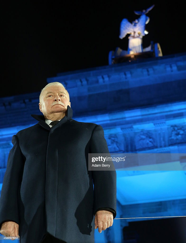 Polish Solidarity (Solidarnosc) Leader Lech Walesa attends celebrations for the 25th anniversary of the fall of the Berlin Wall at the Brandenburg Gate on November 9, 2014 in Berlin, Germany. The city of Berlin is commemorating the 25th anniversary of the fall of the Berlin Wall from November 7-9 with an installation of 6,800 lamps coupled with illuminated balloons along a 15km route where the Wall once ran and divided the city into capitalist West and communist East. The fall of the Wall on November 9, 1989, was among the most powerful symbols of the revolutions that swept through the communist countries of Eastern Europe and heralded the end of the Cold War. Built by the communist authorities of East Germany in 1961, the Wall prevented East Germans from fleeing west and was equipped with guard towers and deadly traps.
