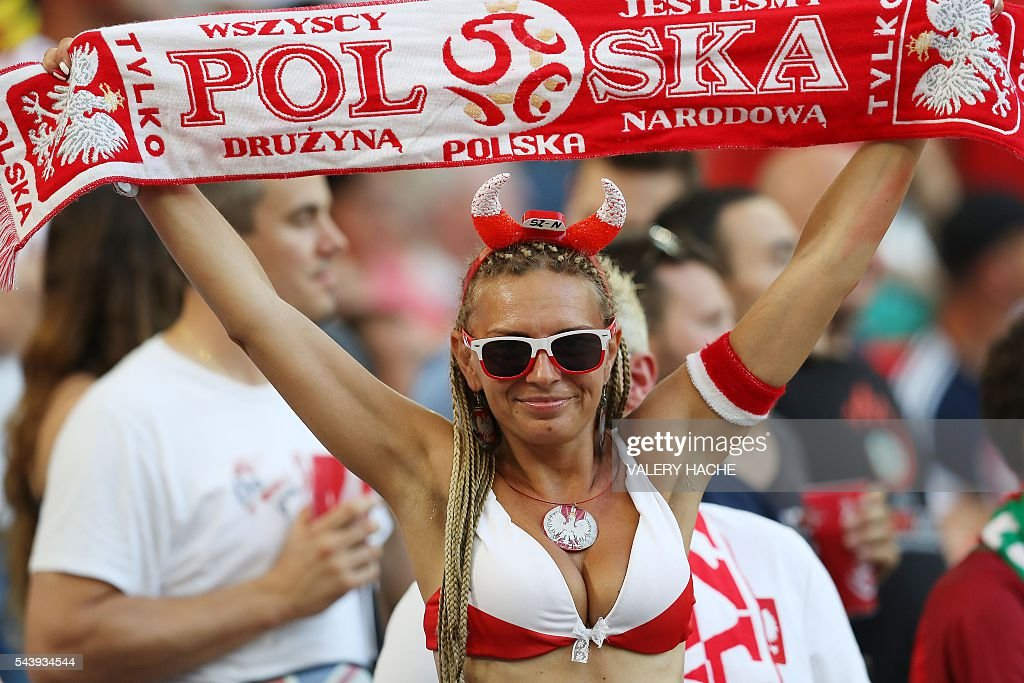 A Polish supporter cheers before the Euro 2016 quarter-final football match between Poland and Portugal at the Stade Velodrome in Marseille on June 30, 2016. / AFP / Valery HACHE