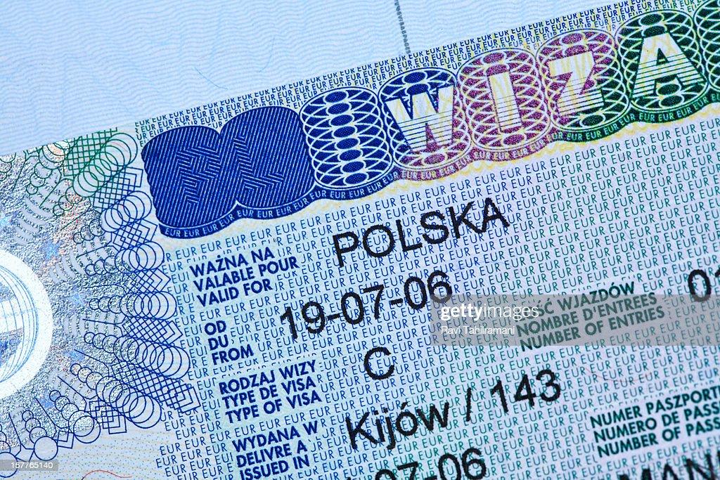 Polish visa stamp in a passport : Stock Photo