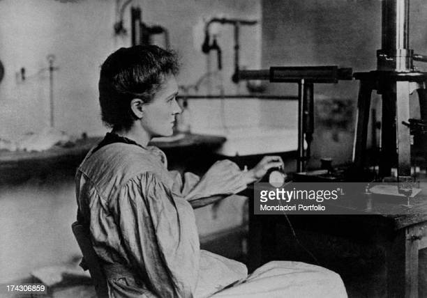 Polishborn Russian and French chemist and physicist Marie Curie sitting in her laboratory 1900s
