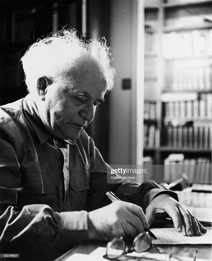 Polishborn Zionist David BenGurion the first Prime Minister of Israel sits writing at a desk 1950s BenGurion was a leader of the Labor Zionist...