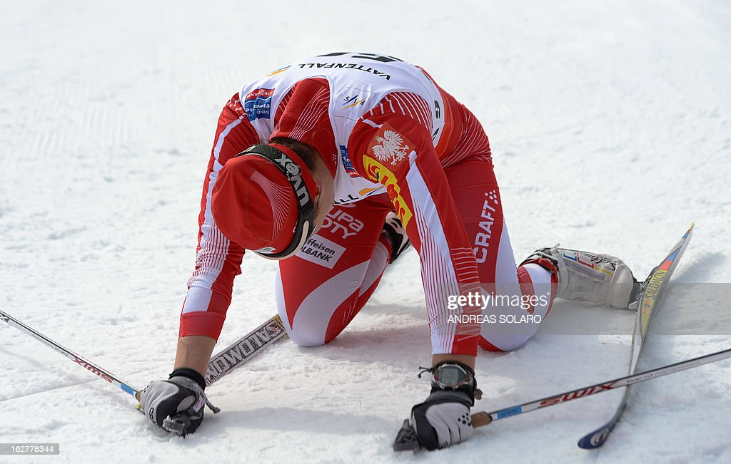 Polish's Sylwia Jaskowiec lies down inside the finish area on February 26, 2013, at the end of the Women's Cross Country skiing 10 Km Free Individual of the FIS Nordic World Ski Championships at Val Di Fiemme Cross Country stadium in Cavalese, north Italy . AFP PHOTO / ANDREAS SOLARO