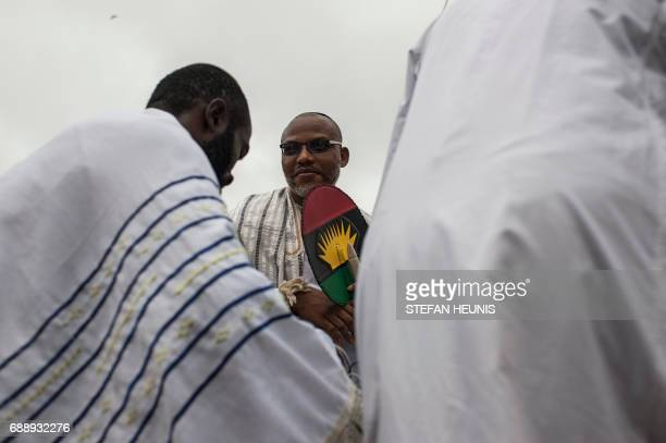 Political activist and leader of the Indigenous People of Biafra movement Nnamdi Kanu stands during celebration of Shabbat outside his house in...