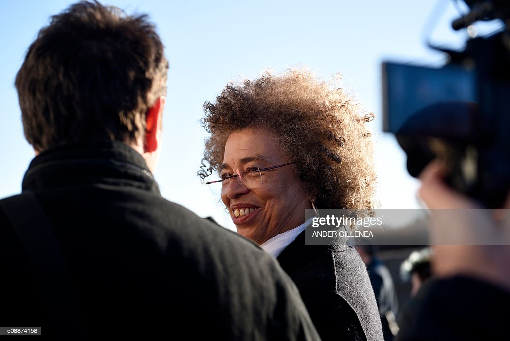 US political activist Angela Yvonne Davis smiles at the son of the imprisoned leader of the Basque Patriotic Left movement Arnaldo Otegi outside the 'Centro Penitenciario de Logrono' prison, after Davis' vain attempt to visit the Basque politician on February 7, 2016, in the northern Spanish city of Logrono. Although Angela Davis had received the permission to visit Otegi, the prison of Logrono finally denied it. Arnaldo Otegi is imprisoned since 2009 and will be released on March 1, 2016. AFP PHOTO / ANDER GILLENEA / AFP / ANDER GILLENEA